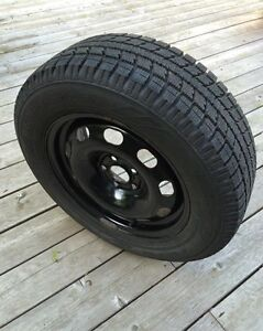 Almost new winter tires on rims for sale