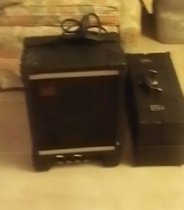 Amps and Speakers and piano and bag.