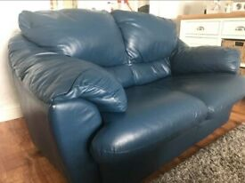 Three and two seater blue leather sofa