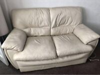 Light leather couch and single chair