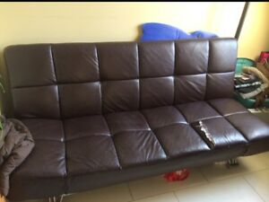 Brown leather couch/futon