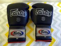 A BOXING PAIR OF FAIRTEX 12 OZ. BOXING GLOVES