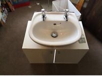 Like new bathroom sink with cabinet and taps