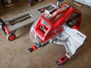 "Milwaukee 12"" sliding mitre saw with stand"