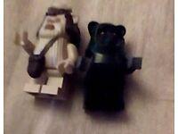 two lego ewoks minifigures one black and one white