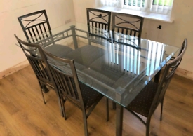 Molasses dining table with 6 chairs. Good condition. Delivery availa