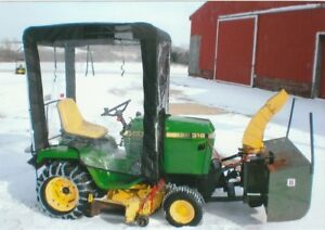 John Deere 318 with mower, blower and cab