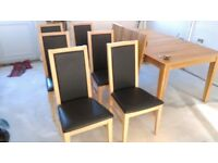 Large Oak table extendible to 2.70 Metres plus 6 matching chairs