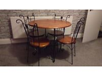 WOOD AND IRON CIRCLE DINING TABLE AND 4 CHAIRS