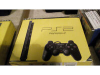 Playstation 2 slim, 22 games, steering wheel and pedals!