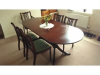 Vintage expendable solid wood table with matching chairs