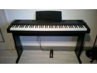 Roland digital piano ep85 and stool