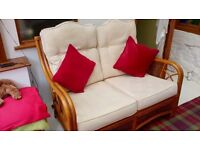 5 piece suite suitable for conservatory. Includes sofa, 2 chairs, 1 stool and a coffee table