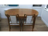 Extending 6-8 person dining table and chairs