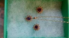 Gold amethyst and diamond neclace and earibgs