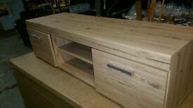 A brand new oak effect finish 2 door 1 shelve TV unit.