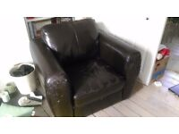 Brown leather-effect armchair