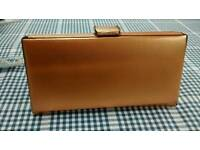 Golden vintage clutch with accessories