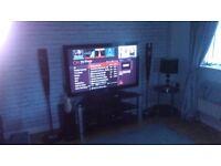 50 inch Samsung plasma HD TV With black glass & silver stand, & surround sound dvd system