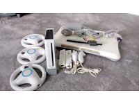 Nintendo Wii Console in great condition with accessories & 4 games. Collection only for £ 50