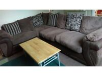 DFS 8 seater sofa - cushioned and comfy with patterned pillows