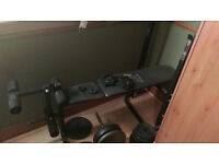 Weight lifting bench with leg developer, weights, barbell, 2x dumbells and gloves (OPEN TO OFFERS)