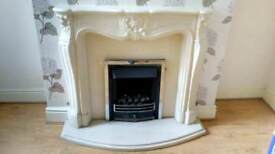 Stone resin fire surround with gas fire