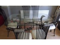 GLASS TABLE & SIX CHAIRS