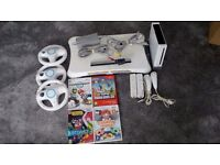 Nintendo Wii in great condition. Accessories inc - Plus 4 great games . Collection only at £45 ono