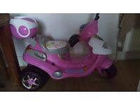 Girls pink electric motor bike . Used twice brilliant condition.