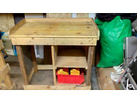 wooden workbench with linnbins and rack