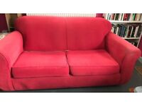 FREE RED SOFA BED (TWO SEATER)