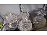 Glass candle holder and three dishes with lids