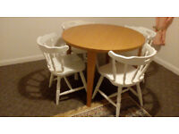 Round table and shabby chic chairs