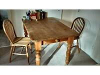 Lovely antique pine table with two chairs