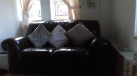 2 seater brown leather sofa with cushions
