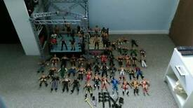 64 wwe figure's and two rings alot of money Worth bargain
