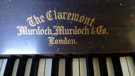 Claremont upright piano, in need of some attention.