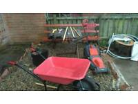 Wheel barrow and strimmer