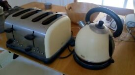 Cream Swan kettle and four-slice toaster.