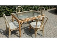 Glass topped cane table & 4 chairs