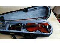 Half size violin and case