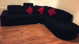 Large black corner sofa complete with scatter cushions! Excellent condition, like new!!