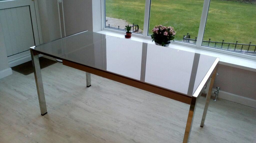 Stunning Extending Glass Stainless Steel Dining Table From The Fenwicks Italian Range