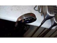 Set of MacGregor golf clubs