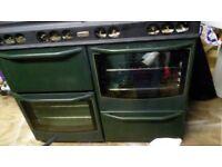 8 burner range gas cooker, green in fair condition