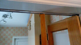 A wooden bi-fold door with frosted glass windows