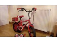 Firechief red boys bike with stabilisers