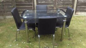 Glass top dining table and 4 faux leather chairs