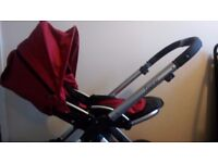 Oyster baby style pram and stroller with carry cot and stroller seat in red and black.
